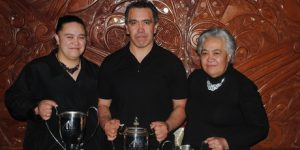 BMX LEGEND: Kevin Tamepo (centre) with all his trophies from the Turangi Sports Awards 2013, a proud moment for mum, Emily (right) and sister Marama (left).